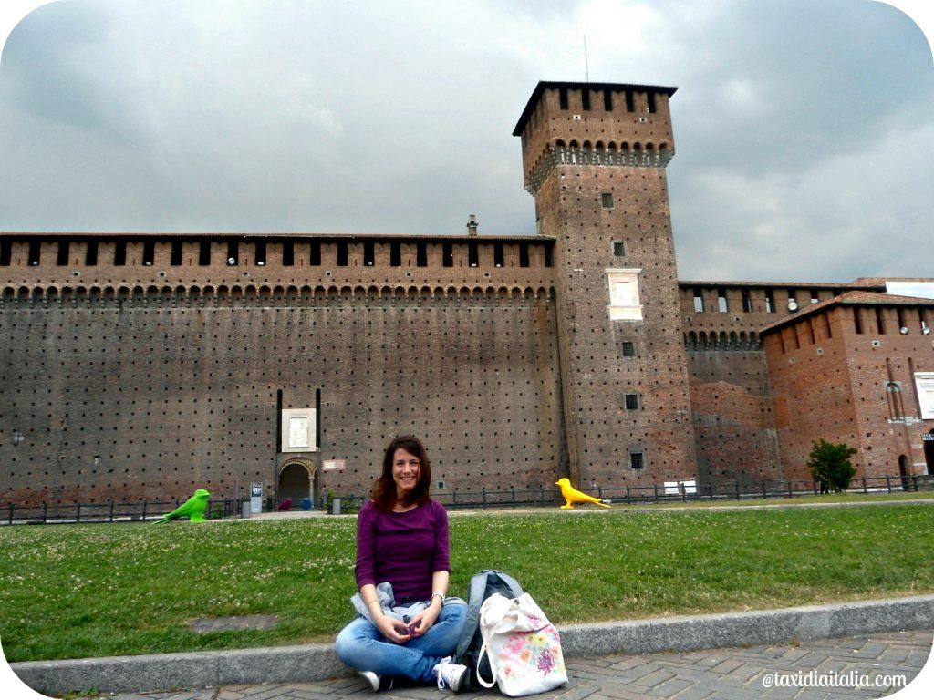 girl sitting in front of castello sforzesco, Milan