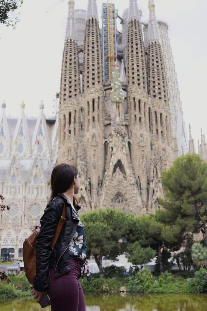 girl in front of sagrada familia in barcelona